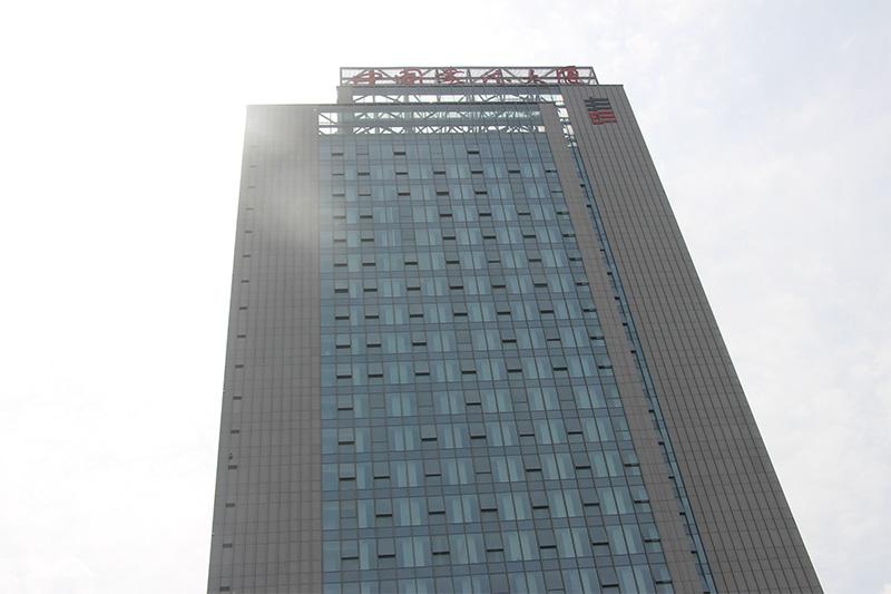 中国书法大厦使用仿石材铝单板案例